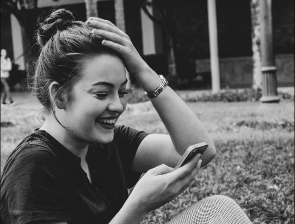 Laughing at a weird text in weird pick up lines